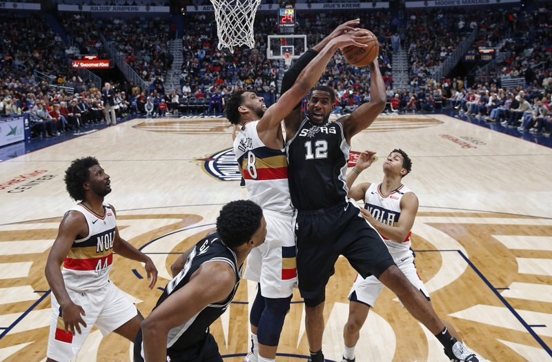 San Antonio Spurs center LaMarcus Aldridge (12) battles under the basket against New Orleans Pelicans center Jahlil Okafor (8) in the first half of an NBA basketball game in New Orleans, Saturday, Jan. (AP Photo/Gerald Herbert)
