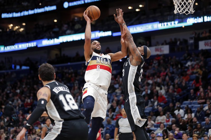 New Orleans Pelicans center Jahlil Okafor (8) goes to the basket against San Antonio Spurs forward Dante Cunningham (33) in the first half of an NBA basketball game in New Orleans, Saturday, Jan. (AP Photo/Gerald Herbert)