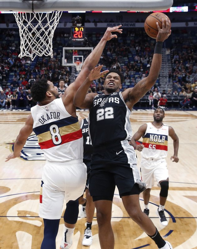 San Antonio Spurs forward Rudy Gay (22) goes to the basket against New Orleans Pelicans center Jahlil Okafor (8) in the first half of an NBA basketball game in New Orleans, Saturday, Jan. (AP Photo/Gerald Herbert)