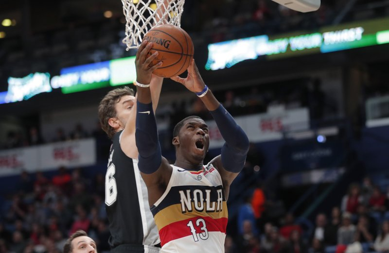New Orleans Pelicans forward Cheick Diallo (13) goes to the basket against San Antonio Spurs center Pau Gasol in the first half of an NBA basketball game in New Orleans, Saturday, Jan. (AP Photo/Gerald Herbert)