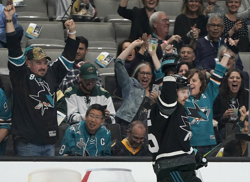 Pacific Division's Erik Karlsson, of the San Jose Sharks, celebrates after scoring a goal against the Central Division during the first half of a semifinal of the NHL hockey All-Star Game in San Jose, Calif. (AP Photo/Tony Avelar)