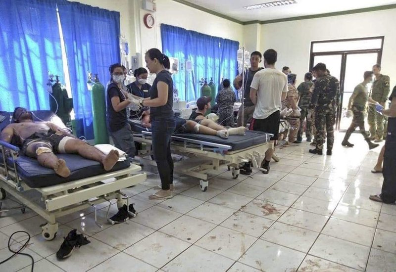 In this photo provided by WESMINCOM Armed Forces of the Philippines, bomb victims receive treatment in a hospital after two bombs exploded outside a Roman Catholic cathedral in Jolo, the capital of Sulu province in southern Philippines where militants are active Sunday, Jan. (WESMINCOM Armed Forces of the Philippines Via AP)
