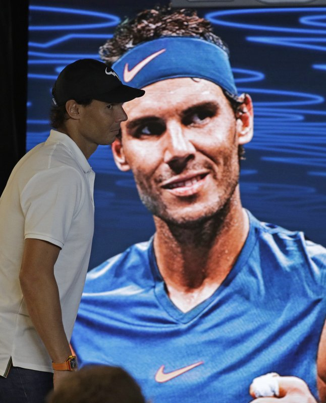 Spain's Rafael Nadal arrives at a press conference after losing to Serbia's Novak Djokovic in the men's singles final at the Australian Open tennis championships in Melbourne, Australia, Sunday, Jan. (AP Photo/Kin Cheung)