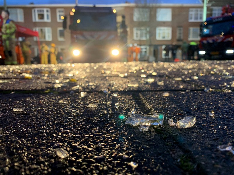 Shattered glass lies on the ground after a three-story home collapsed in The Hague, Netherlands on Sunday, Jan. (AP Photo/Wong Maye-E)
