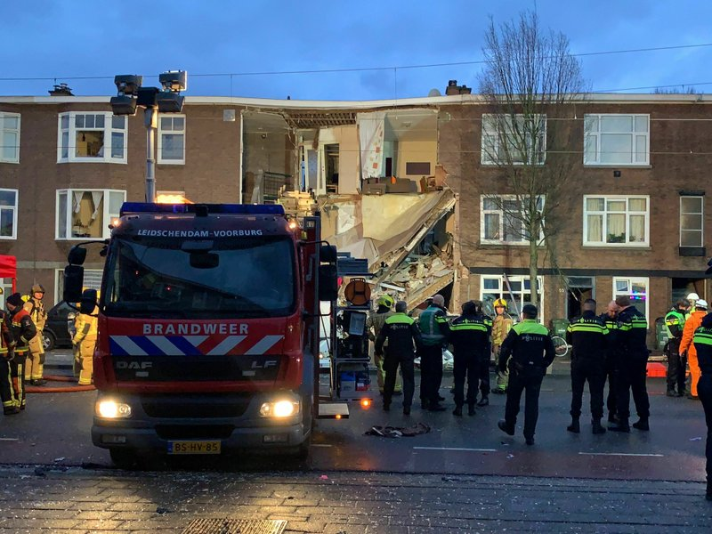 Authorities respond after a three-story home collapsed in The Hague, Netherlands on Sunday, Jan. 27, 2019. (AP Photo/Wong Maye-E)