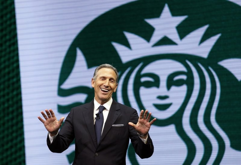 FILE - In this March 22, 2017 file photo, Starbucks CEO Howard Schultz speaks at the Starbucks annual shareholders meeting in Seattle. (AP Photo/Elaine Thompson, File)