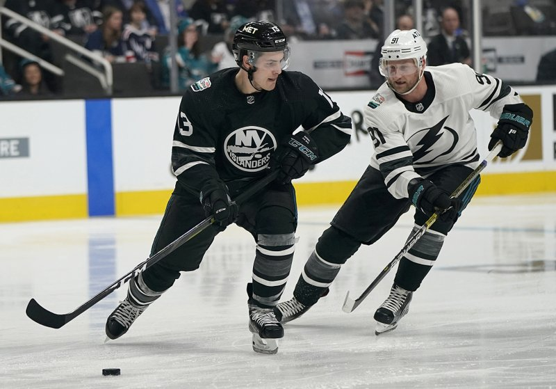 Metropolitan Division's Mathew Barzal, left, of the New York Islanders, skates in front of Atlantic Division's Steven Stamkos, of the Tampa Bay Lightning, during the first half of an NHL hockey All-Star Game semifinal in San Jose, Calif. (AP Photo/Tony Avelar)