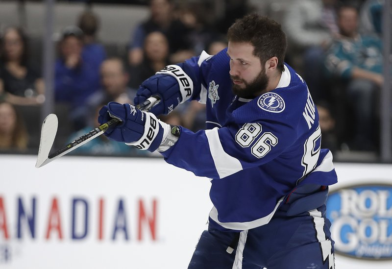 Tampa Bay Lightning's Nikita Kucherov watches a puck in the accuracy shooting event during the skills competition, part of the NHL hockey All-Star weekend in San Jose, Calif. (AP Photo/Ben Margot)