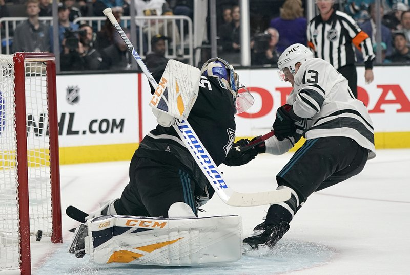 Metropolitan Division's Cam Atkinson, right, of the Columbus Blue Jackets, scores against Central Division's Pekka Rinne, of the Nashville Predators, during the second half of the NHL hockey All-Star Game final in San Jose, Calif. (AP Photo/Tony Avelar)