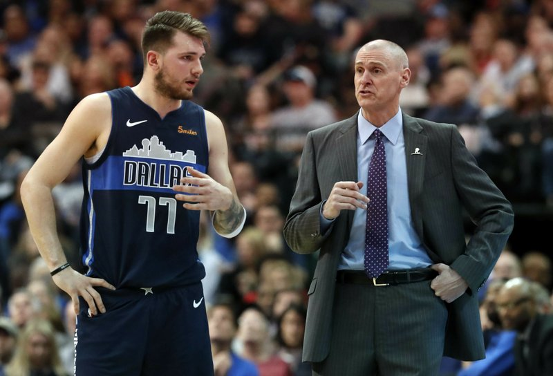 Dallas Mavericks forward Luka Doncic (77) listens to head coach Rick Carlisle on the sideline during the first half of an NBA basketball game against the Toronto Raptors in Dallas, Sunday, Jan. (AP Photo/LM Otero)