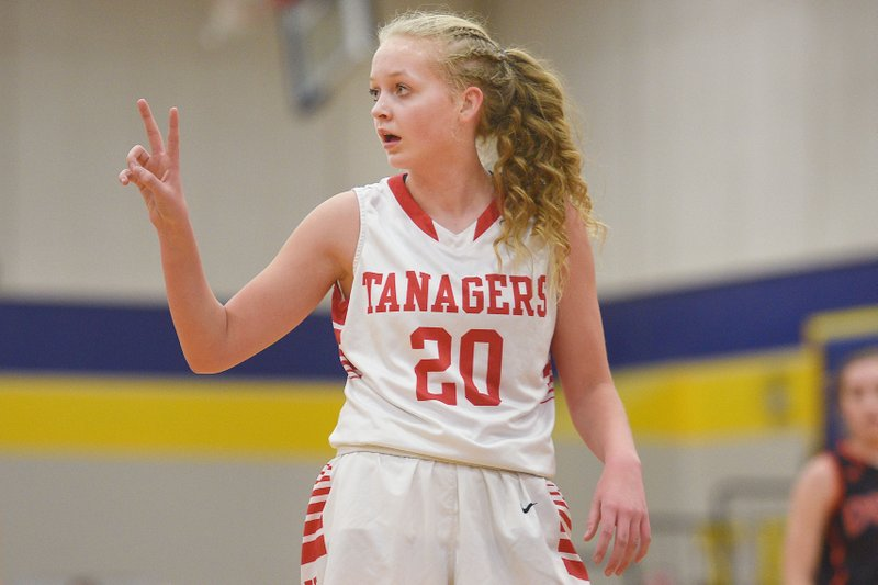 In this March 1, 2018 photo, Vermillion's Lexi Plitzuweit gestures to her coach during a girl's high school basketball game against Dell Rapids at Tea Area High School in Tea, S. (Briana Sanchez/The Argus Leader via AP)