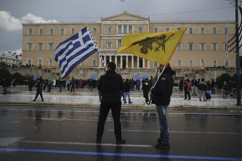 Opponents of the Prespa Agreement participate in a protest rally outside the Greek Parliament, in Athens, Friday, Jan. (AP Photo/Petros Giannakouris)