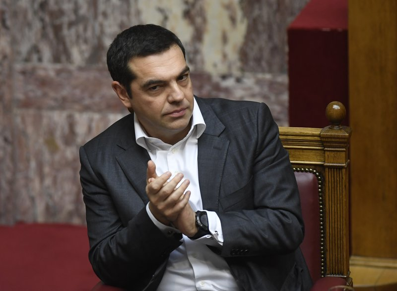 Greece's Prime Minister Alexis Tsipras applauds during a parliament debate about the Prespa Agreement in Athens, Friday, Jan. (AP Photo/Michael Varaklas)
