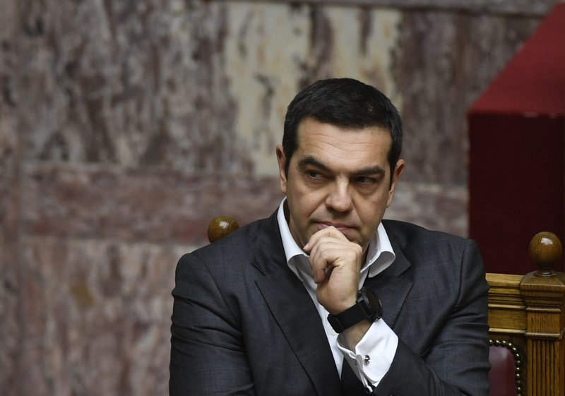 Greece's Prime Minister Alexis Tsipras pauses during a parliament debate about the Prespa Agreement in Athens, Friday, Jan. (AP Photo/Michael Varaklas)