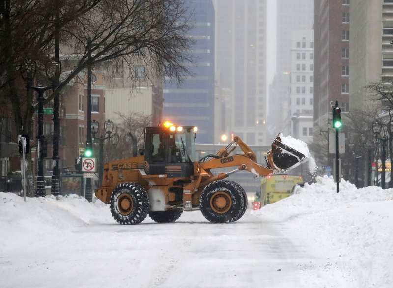 A plow removes snow along West Wisconsin Avenue at North 8th Street in Milwaukee on Monday, Jan. 28, 2019. (Mike De Sisti/Milwaukee Journal-Sentinel via AP)