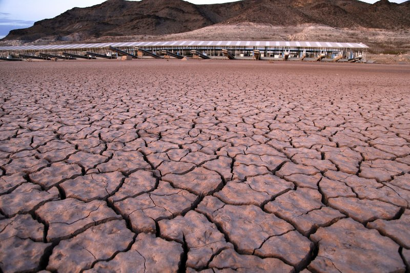 FILE - In this July 16, 2014 file photo, what was once a marina sits high and dry due to Lake Mead receding in the Lake Mead National Recreation Area in Arizona. (AP Photo/John Locher, File)