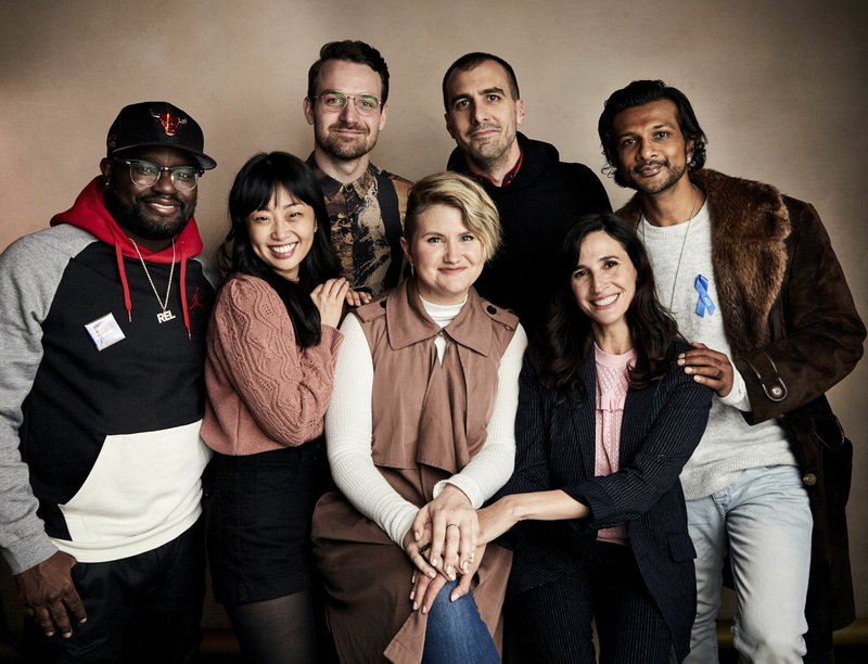 Lil Rel Howery, from left, Alice Lee, Micah Stock, Jillian Bell, director Paul Downs Colaizzo, Michaela Watkins and Utkarsh Ambudkar pose for a portrait to promote the film