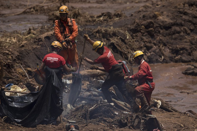 Firefighters looks for victims inside a vehicle days after a dam collapse in Brumadinho, Brazil, Monday, Jan. (AP Photo/Leo Correa)