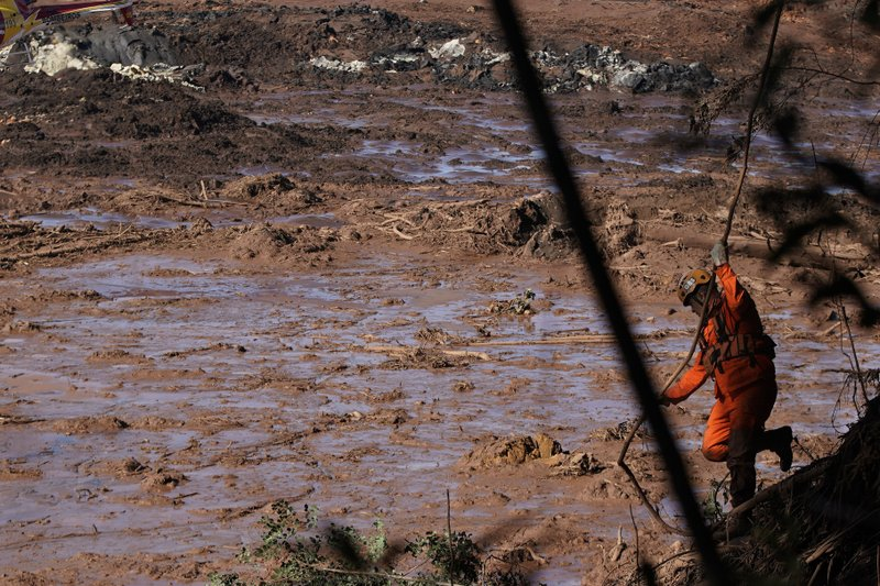 A firefighter looks for victims in the mud, days after a dam collapse in Brumadinho, Brazil, Monday, Jan. (AP Photo/Leo Correa)