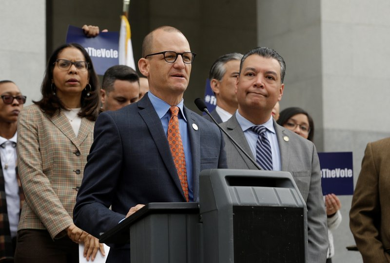 Assemblyman Kevin McCarty, D-Sacramento, discusses his proposed constitutional amendment to allow parolees to vote as Secretary of State Alex Padilla, right, looks on during a news conference at the Capitol, Monday Jan. (AP Photo/Rich Pedroncelli)