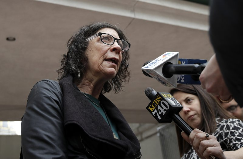 Mindy Spatt, a spokeswoman for The Utility Reform Network, speaks with reporters before a California Public Utilities Commission meeting in San Francisco, Monday, Jan. (AP Photo/Jeff Chiu)