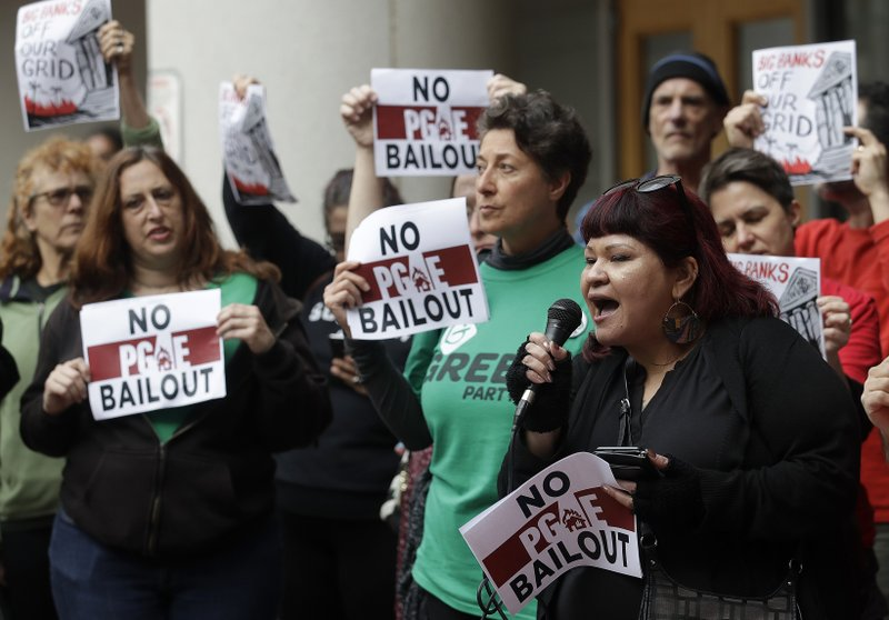 Jessica Tovar, right, speaks at a rally before a California Public Utilities Commission meeting in San Francisco, Monday, Jan. (AP Photo/Jeff Chiu)