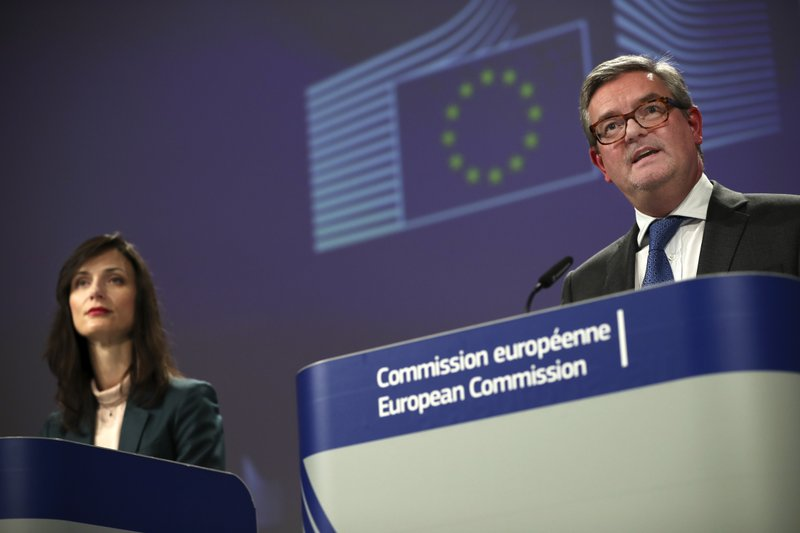 EU Commissioner for Security Union Julian King, right, talks to journalists during a joint news conference with EU Commissioner for Digital Economy Mariya Gabriel at the European Commission headquarters in Brussels, Tuesday, Jan. (AP Photo/Francisco Seco)