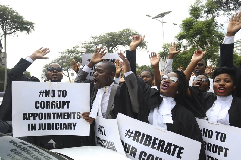 Zimbabwe lawyers take part in a protest over rule of law concerns in Harare, Tuesday Jan. 29, 2018. The lawyers handed over a petition to the country's Chief Justice in a bid to stop human rights abuses in the country. (AP Photo/Tsvangirayi Mukwazhi)