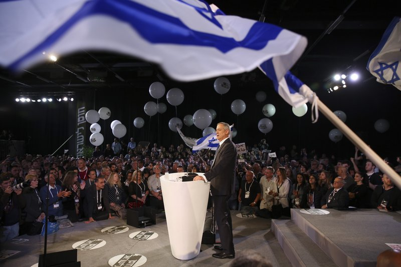 Retired Israeli military chief Benny Gantz speaks at the official launch of his election campaign for the April 2019 elections, in Tel Aviv, Tuesday, Jan. (AP Photo/Oded Balilty)