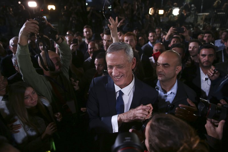 Retired Israeli military chief Benny Gantz greets supporters at the official launch of his election campaign for the April 2019 elections, in Tel Aviv, Tuesday, Jan. (AP Photo/Oded Balilty)
