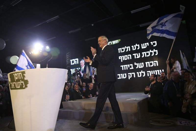 Retired Israeli military chief Benny Gantz walks at the podium during the official launch of his election campaign for the April 2019 elections, in Tel Aviv, Tuesday, Jan. (AP Photo/Oded Balilty)