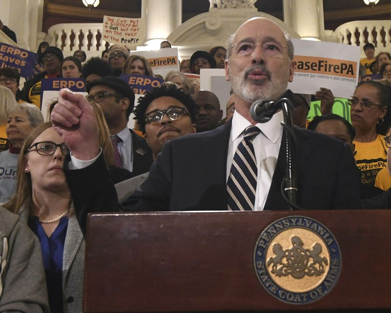 Gov. Tom Wolf speaks at a rally in the Pennsylvania Capitol's rotunda calling for lawmakers to take action on anti-gun violence legislation on Tuesday, Jan. (AP Photo/Marc Levy)