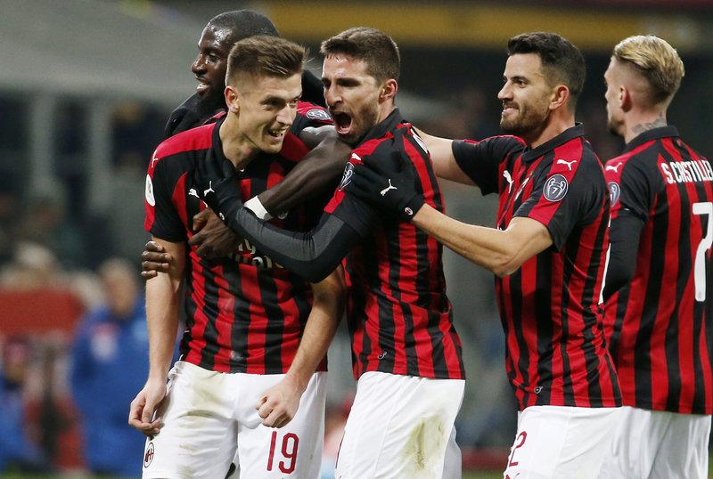 AC Milan's Krzysztof Piatek, second from left, celebrates with his teammates after scoring his side's second goal during an Italian Cup quarter-final soccer match between AC Milan and Napoli at the San Siro stadium, in Milan, Italy, Tuesday, Jan. (AP Photo/Antonio Calanni)