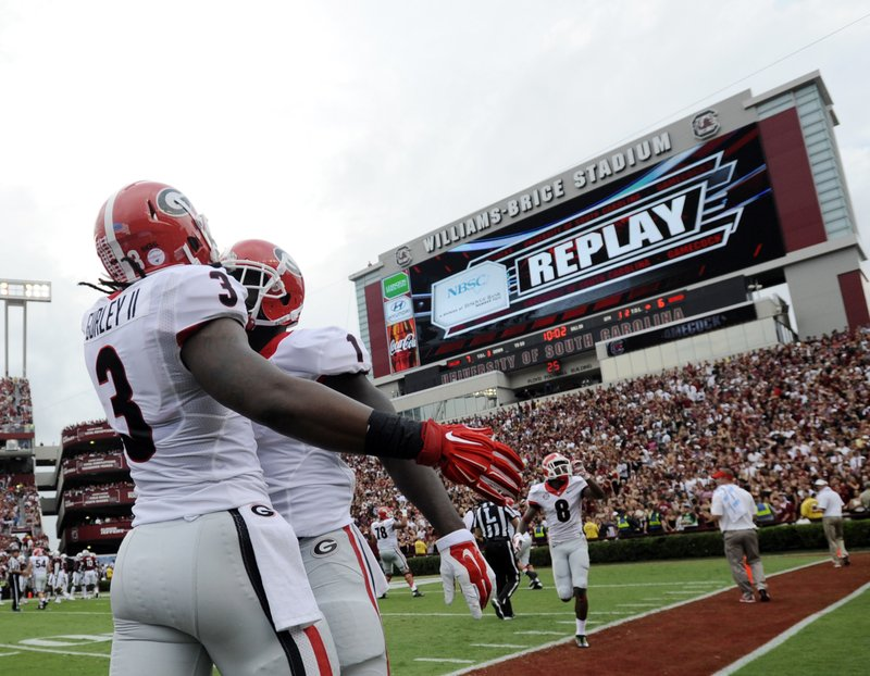 FILE- In this Sept. 13, 2014, file photo, Georgia running back Sony Michel (1) celebrates with teammate Todd Gurley (3) after scoring a touchdown against South Carolina during the first half of an NCAA college football game in Columbia, S. (AP Photo/Rainier Ehrhardt, File)
