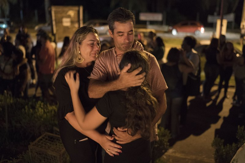A family embraces during a vigil for the victims of the collapsed mining company dam in Brumadinho, Brazil, Tuesday, Jan. (AP Photo/Leo Correa)