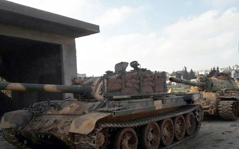 This photo released Saturday, Jan. 5, 2019, by the al-Qaida-affiliated Ibaa News Agency, shows tanks captured by al-Qaida-linked fighter of Hayat Tahrir al-Sham, or HTS, from the Turkey-backed Nour el-Din el-Zinki group in the western countryside of Aleppo province, Syria. (Ibaa News Agency, via AP)