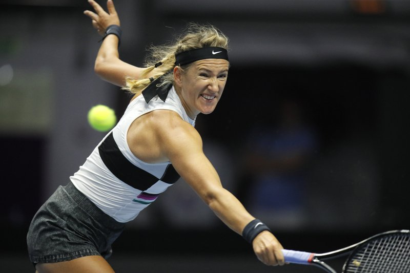 Victoria Azarenka of Belarus returns the ball to Petra Kvitova of Czech Republic during the St. Petersburg Ladies Trophy-2019 tennis tournament match in St. (AP Photo/Dmitri Lovetsky)