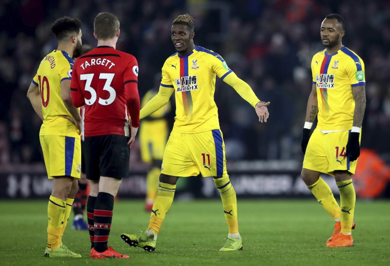 Crystal Palace's Wilfried Zaha leaves the pitch after being sent off during their English Premier League soccer match against Southampton at St Mary's Stadium in Southampton, England, Wednesday Jan. (Nick Potts/PA via AP)