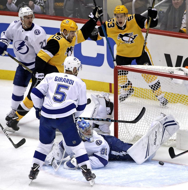Pittsburgh Penguins' Riley Sheahan (15) celebrates his goal past sprawling Tampa Bay Lightning goaltender Andrei Vasilevskiy (88) with Teddy Blueger (53) during the first period of an NHL hockey game in Pittsburgh, Wednesday, Jan. (AP Photo/Gene J. Puskar)