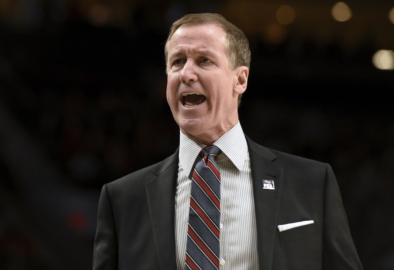 Portland Trail Blazers coach Terry Stotts yells to the officials during the first half of the team's NBA basketball game against the Utah Jazz in Portland, Ore. (AP Photo/Steve Dykes)