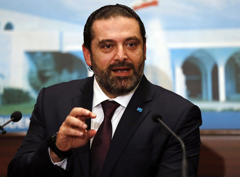 Newly-assigned Lebanese Prime Minister Saad Hariri, speaks to journalists at the presidential palace in Baabda, east of Beirut, Lebanon, Thursday, Jan. (AP Photo/Hussein Malla)