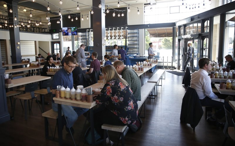FILE  - In this May 9, 2018, file photo, customers dine at the Wursthall Restaurant & Bierhaus in San Mateo, Calif. (Michael Mayor/San Francisco Chronicle via AP, File)