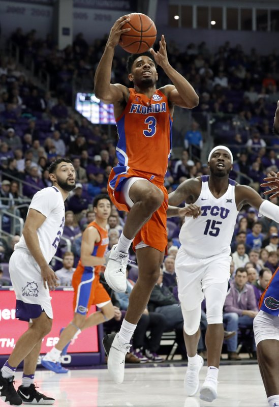 FILE - In this Saturday, Jan. 26, 2019, file photo, Florida guard Jalen Hudson (3) breaks to the basket after getting past TCU's Alex Robinson, left, and JD Miller (15) in the first half of an NCAA college basketball game in Fort Worth, Texas. (AP Photo/Tony Gutierrez, File)