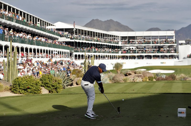 Harold Varner III hits from the 16th tee during the first round of the Phoenix Open PGA golf tournament, Thursday, Jan. (AP Photo/Matt York)