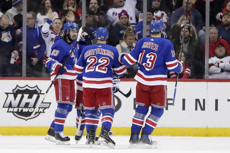 New York Rangers celebrate a goal by Mika Zibanejad, left, of Sweden, during the second period of an NHL hockey game against the New Jersey Devils, Thursday, Jan. (AP Photo/Julio Cortez)