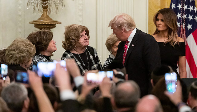 President Donald J. Trump, joined by First Lady Melania Trump, shakes hands with Holocaust survivors during a Hanukkah reception Thursday, Dec. 6, 2018, in the East Room of the White House. (Official White House Photo by Andrea Hanks)