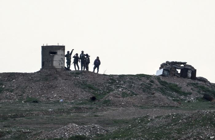 Fighters of People's Protection Units, or YPG, gather at their outpost we