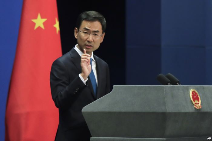FILE - Chinese Foreign Ministry spokesman Geng Shuang gestures as he speaks d