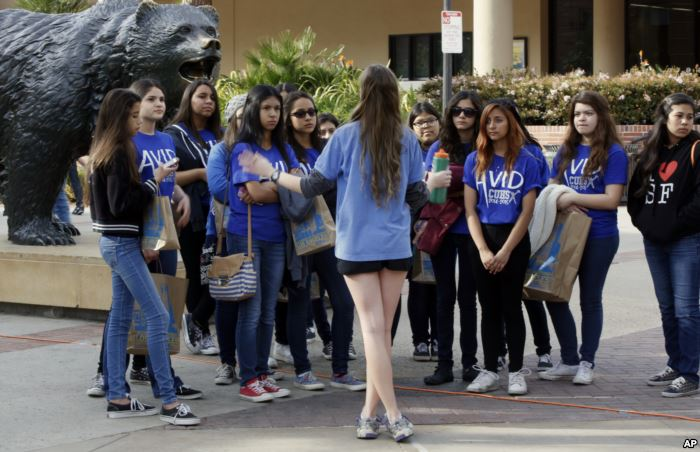 FILE - In this Feb. 26, 2015, file photo, a UCLA campus tour guide leads pros