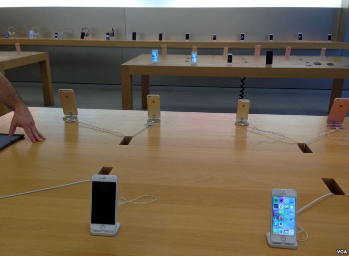 FILE - iPhones on display at an Apple store in Virginia, USA, April 4, 2016.